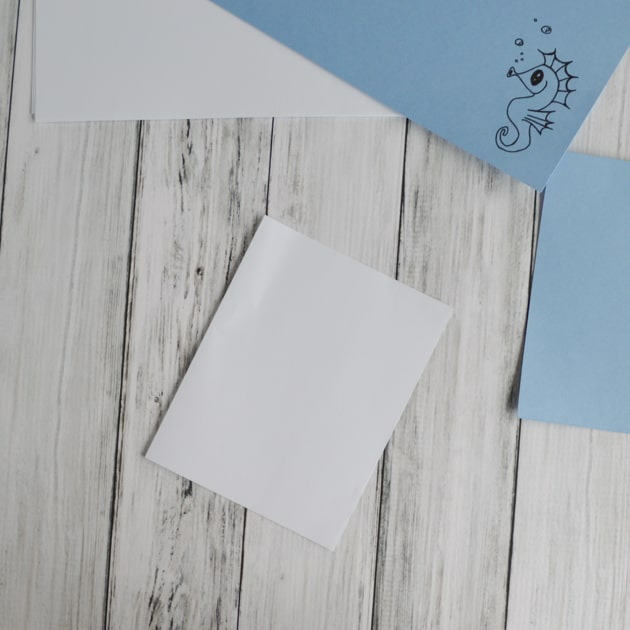 fold one sheet of paper in half