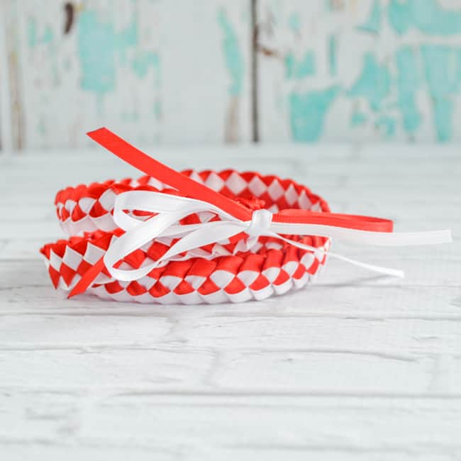 red and white ribbon lei