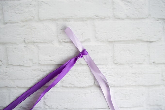 make a bunny ear with the ribbon