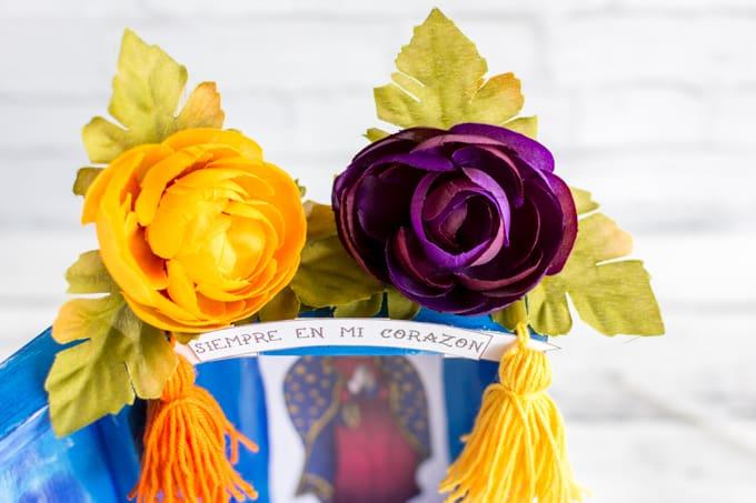 flowers on santa muerte nicho
