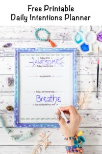 Free printable daily intentions planner in a galaxy frame with overlay text